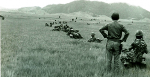phou-keng-1970-under-attack-the-path-is-to-the-left-of-the-standing-guys-shoulder_resize